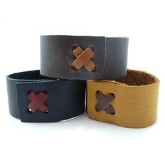 """Adjustable Leather Crossband Bracelet for Men or Women, Black Modern Artisans. $14.99. One size fits all - bracelet is easily adjustable between 6.5"""" and 8.5"""". 1.25-inch-wide leather cuff. Handmade in the USA. Simple, stylish leather cross band serves as the crowing compliment to the leather bracelet. Perfect for men or women"""