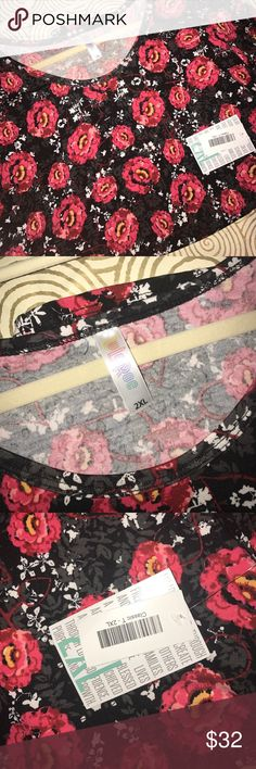 BNWT 2xl classic tee lularoe black w/ red blooms BNWT 2xl classic tee lularoe black w/ red blooms - gorgeous!! White and gray details too. LuLaRoe Tops Tees - Short Sleeve