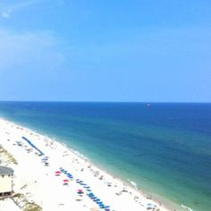 Gulf shores, Alabama  One of the blue chairs and umbrella are needing me to visit again.