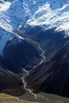 Landscape Photography | Snow cap mountains into valley river