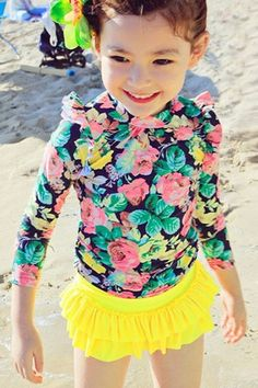 Dive into a flowering environment with this floral print rash guard, skirted swim bottoms and swimming cap by Liverpool Private Reserve. #KidsStyle #Fashion #ChildrenDress