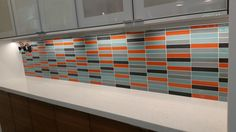 Look at how this clean, #chic #backsplash pops in this #modern #kitchen   #home #homedecor #homeinterior #homedesign #homeinspo #homedecoration #decor #deco #design #designer #interiordesign #interiordecor #interiorstyling #interior4all #interior123 #subwaytile #tile #orange #blue #kitchendesign #instagood #instastyle #style #trend #remodel #renovate
