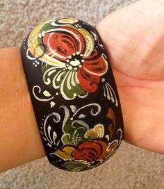 Love this cuff bracelet. Getting back to her Norwegian roots. Etsy listing at http://www.etsy.com/listing/111949949/norwegian-rosemaled-cuff-bracelet-ooak