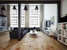 Many might choose to decorate a former industrial space with hard surfaces, poured concrete floors and exposed metal beams. It's a style that has become very popular of late and in the right hands it can be truly sensational. The banker owner of this penthouse in Chelsea however, wisely put design decisions into the hands