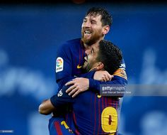 Lionel Messi of FC Barcelona celebrates with his teammates Luis Suarez of FC Barcelona after scoring his team's fourth goal during the La Liga match between Real Sociedad and FC Barcelona at Estadio Anoeta on January 14, 2018 in San Sebastian, Spain.