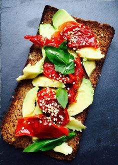 Rye bread, avocado, lemon, dried tomatoes, basil, sesame seeds, olive oil