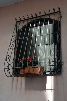 Window with Grille, Flowers and Curtain, Procida (NA) Home Window Grill Design, Iron Window Grill, Balcony Grill Design, Window Design, Iron Windows, Windows And Doors, Window Security Bars, Burglar Bars, Window Bars