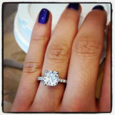 Cushion cut diamond on a petite pave engagement ring