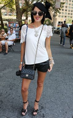 Ginger Harris from New York Fashion Week Spring 2015 Street Style    Bold accessories add zest to a black and white ensemble.