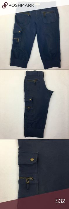 MICHAEL Kors Capri Zipper Cargo Joggers MICHAEL Kors Capri Zipper Cargo Joggers  Cargo pants Capri Joggers Zipper pockets Michael by Michael Cors Thick jogging material 96% cotton 4% spandex Stretchy Two buttons at the bottom of each leg MICHAEL Michael Kors Pants Track Pants & Joggers
