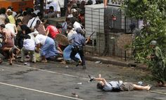 Reuters photographer Adrees Latif won the Pulitzer Prize for Breaking News Photography in 2008 for this picture of a Japanese videographer shot during a governmental crackdown on demonstrators in Myanmar. The reporter, Kenji Nagai, still attempted to videotape the violence as he lay injured after police shot him. Nagai would eventually die from his wounds.
