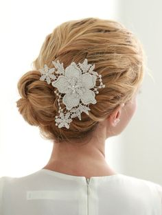 STYLE - #112 CODE:HRP001 Shooting star hairpin. features hand-cut lace appliqué with sparkling beads in the centre. to order yours contact us at loca@localoca.co.za www.localoca.co.za