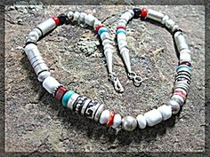 Wearable Art Tommy Singer Necklace 20 inches long White Buffalo Turquoise Coral Spiney Oyster with 2 of Tommy's Sterling Silver and Gold Signature Barrel beads and Sterling Silver Barrel Beads with the signature logo Sterling Silver tag near the clasp