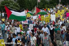 Some 10,000 demonstrators march through downtown Washington, D.C., to protest Israel's offensive in Gaza, August 2, 2014