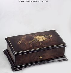 Exquisite REUGE music box with very soft inlaid roses in beautiful walnut burl... 9.5 x 5.5 x 3 inches... High gloss finish and edged with an ebony black beveled edge... One of a kind to find today.. Your choice of wonderful Reuge/Romance 72 note movements..Plays Canon In D(3 Parts)//Pachelbel