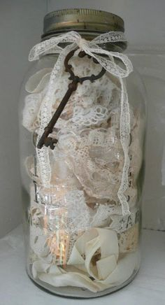 vintage lace in a jar with a pretty key