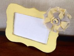 Each frame is hand-painted, distressed, and embellished with a fabric flower. Adds a beautiful decorative touch to your home and also makes