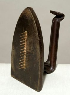 """Man Ray (b. 1890 - d. 1976, American), """"Cadeau"""" ('A Gift'), Iron multiple with Copper Nails, Size: 17,8 x 9,4 x 12,6 cm. (7 x 3 ⅝ x 4 ⅞ inches), Sculpture (The object has a layer of varnish, to protect the artist's Inscriptions in Oil Crayon), at 'Tate Modern Art Gallery', London, UK, (acquisition 2002 / 5 trial pieces made by M. Ray for an editionof 12, 'Galleria Il Fauno', Italy, 1972), Signed, [1921 (stolen), editioned 'Replica' 1972) ~ © Man Ray Trust/ADAGP, Paris and DACS, London 2018."""