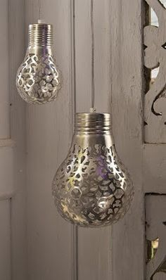 Quirky light!  Spray paint a doily onto a light bulb or use a silver pen and draw your own designs. When the light shines through, it will cast a beautiful pattern on your walls.