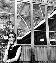 Capucine posing in a hotel in Rome wearing dress by Givenchy, photo by Marisa Rastellini, Rome, 1962