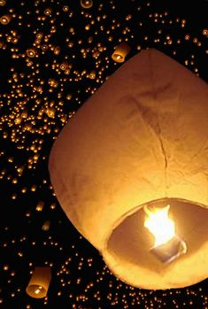 We have always wanted to be at a party where the guests release paper lanterns into the night sky.
