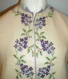 "detail of embroidery - Magnificent 1860's Civil War Era Embroidered Cashmere Jacket | eBay seller fiddybee; extensively embroidered with two shades of purple flowers & green leaves, neck trimmed with pale lavender Van Dyke silk points, sleeves & hem trimmed with lilac silk fringe, lined in ivory silk, front hook & eye closure, some underarm discoloration on inside, a few tiny surface moth nips; bust: 38""; waist: 46""; length not including fringe: 23"""