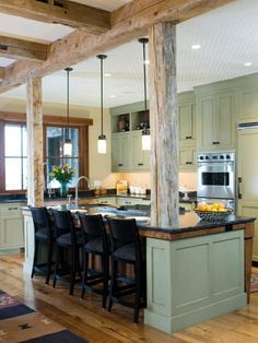 reclaimed beams for the half wall? -- Like the cabinets with the open space on top to decor it... Wood and color
