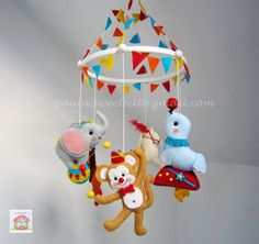 To decorate and amuse your baby, here is the Circus baby mobile! Good idea for a birth gift. Dont wash, just clean with an humid towel without