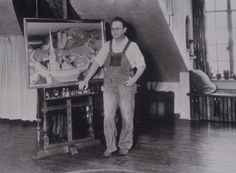 """Grant Wood is shown next to the unfinished painting, """"Midnight Ride of Paul Revere,"""" at 5 Turner Alley, 1931, Cedar Rapids Museum of Art Archives."""