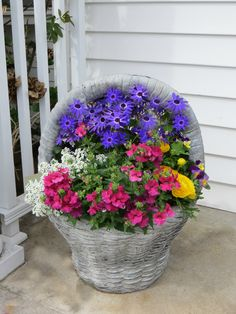 Bright happy colors in this stone basket planter* Basket Planters, Flower Planters, Garden Planters, Container Flowers, Container Plants, Container Gardening, Summer Plants, Summer Flowers, Beautiful Flower Arrangements