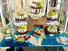 Nothing Bundt Cakes for wedding cake also got some cupcakes to contrast with all the other bundt cakes added florals for an extra touch and doilies.. rustic wedding rustic cake the newland barn huntington Beach
