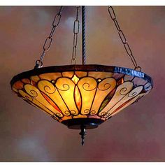 <li>Tiffany-style stained glass lamp is sure to brighten your home decor <li>Gorgeous lamp contains multiple cuts of glass <li>Elegant inverted hanging lamp is sure to dress up any room in your home or office