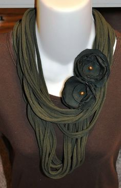 Forest green scarf made from recycled t- shirt. The flowers are made from the lining from a jacket.