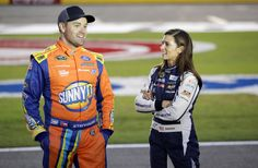 Danica Patrick Photos Photos - Ricky Stenhouse Jr, driver of the #17 SunnyD Ford, and Danica Patrick, driver of the #10 Aspen Dental Chevrolet, talk during qualifying for the NASCAR Sprint Cup Series Bank of America 500 at Charlotte Motor Speedway on October 6, 2016 in Charlotte, North Carolina. - Charlotte Motor Speedway - Day 1