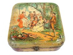 Vintage British lithographed biscuit tin with courtly love scene scene. Antique Huntley and Palmers biscuit tin.