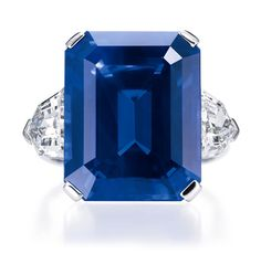 Magnificent Sapphire Ring. Emerald-cut sapphire, 17.54 carats; 2 shield-shaped side stones, 2.50 carats; platinum setting.