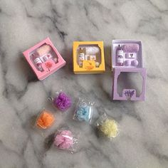 More toiletry gift boxes and bath poufs #miniature #soapshop #soap #handmade #dollhouseminiatures #dollhouseaccessories #pastel #oneinchscale #dollhouse