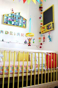 yellow nursery - crib is really cute.