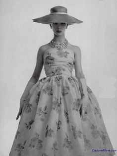 Pretty roses printed on silk and fashioned into a deceptively simple dress by Christian Dior, 1956.