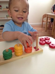 Children in the toddler classroom can learn counting from one to five using simple colored rings. Learning to match the symbol with a quantity, rather than merely a sequence, is an important cornerstone of the Montessori Math curriculum.
