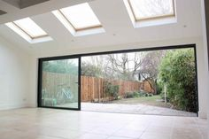 A beautiful and spacious rear kitchen extension carried out by Simply Extend to a home in Teddington. Extension Veranda, House Extension Plans, Conservatory Extension, House Extension Design, Extension Designs, Glass Extension, Rear Extension, Orangery Extension Kitchen, Living Room Extension Ideas