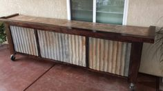 I built this bar from reclaimed 2x4s and patina corrugated metal siding. 10 feet long on rolling and locking casters. The top is covered in 12x12 inch linoleum because of how strong and cheap it is. $1 per tile at most big box stores. Edward Martinez #airplayairbrush Fresno California