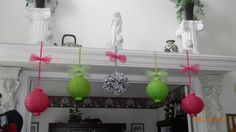 I decorated the mantel located in my foyer with dollar store paper lanterns and I put a ribbon and a bow made out of tule. I made the  zebra pom pom ball with zebra tissue paper (hobby lobby).