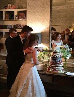 Jim and Tanya cutting the cake.