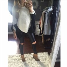 Black and white knit Bought from another posher!(@franki) Poncho style, perfect to wear casually with leggings or dress it up with jeans and booties. NWOT. Size medium. No trades  will go lower on merc Oliviacious Sweaters Shrugs & Ponchos