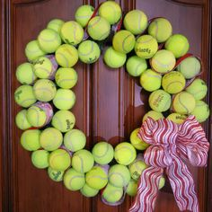 Tennis Ball Wreath - but with baseballs and black & orange ribbon.  GO GIANTS!