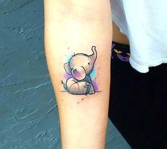 Cute little baby elephant on the arm.