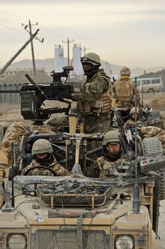 Members of 27 Squadron, RAF Regiment pictured on patrol near Kandahar Airfield, Afghanistan, January 2010. Note the Trijicon ACOG sight fitted to the Grenade Machine Gun (GMG) mounted on the roll bars of the WMIK Land Rover. The GMG fires 40mmx51mm HEDP (high Explosive Dual Purpose) ammunition