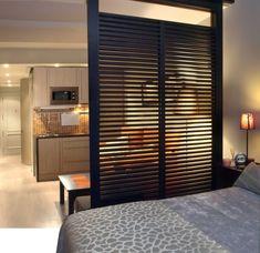 Отличное разделение пространства комнаты на кухню и спальню.