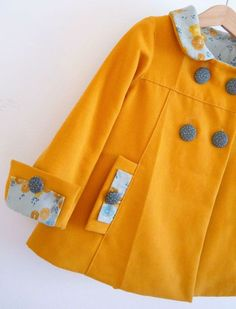 My grandma made all my mom's clothes when she was a kid, including coats! Someday...